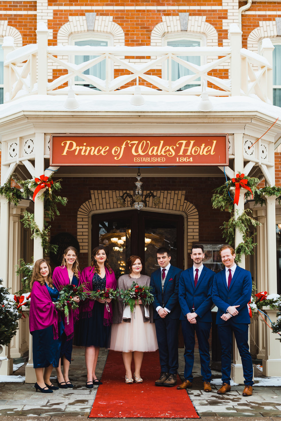 bride and groom with their wedding party outside Prince of Wales Hotel Niagara wedding