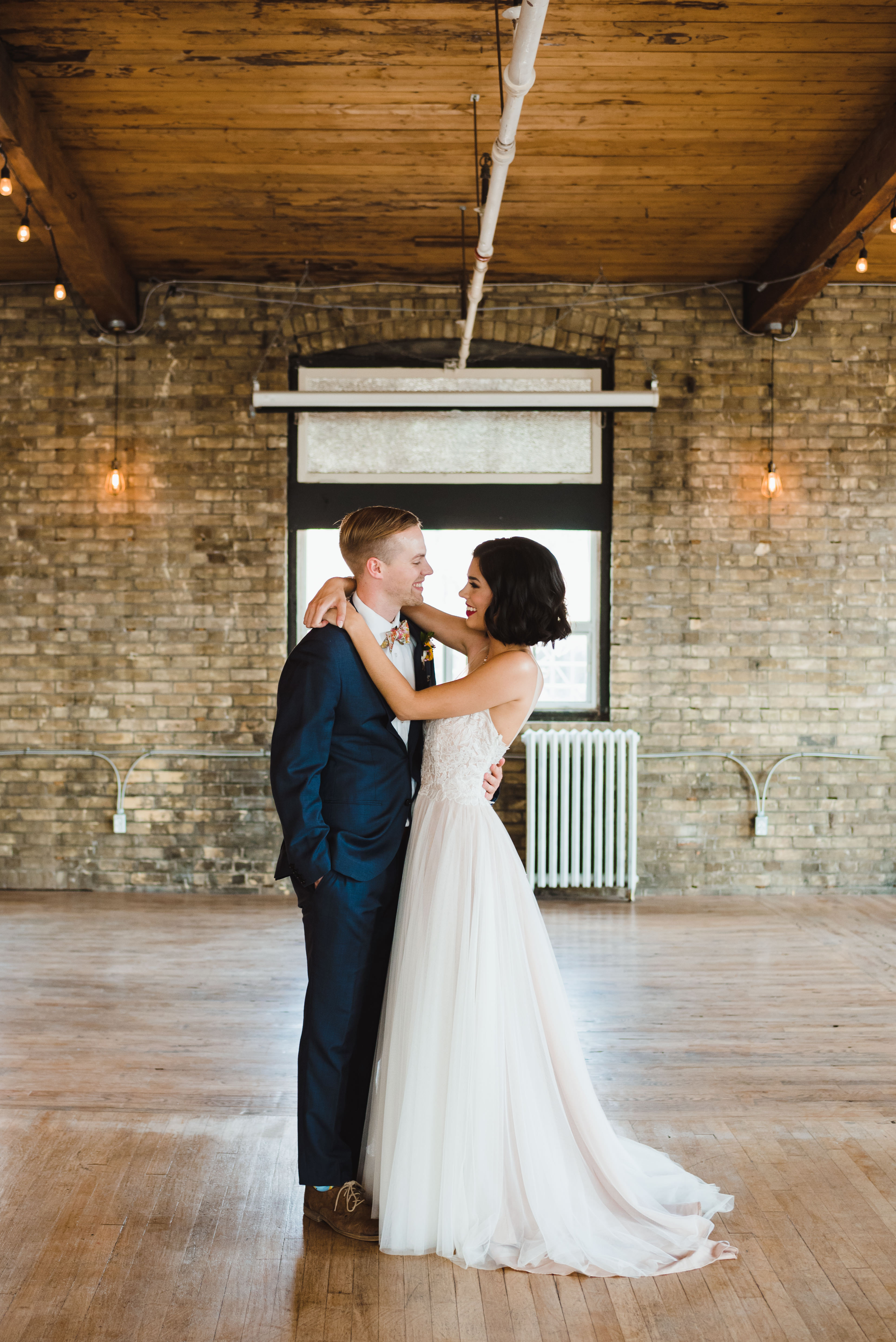 bride and groom slow dancing inside old brick building Toronto wedding photography