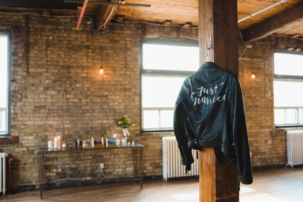 just married leather jacket hanging on wooden post at the Jam Factory Toronto wedding photography
