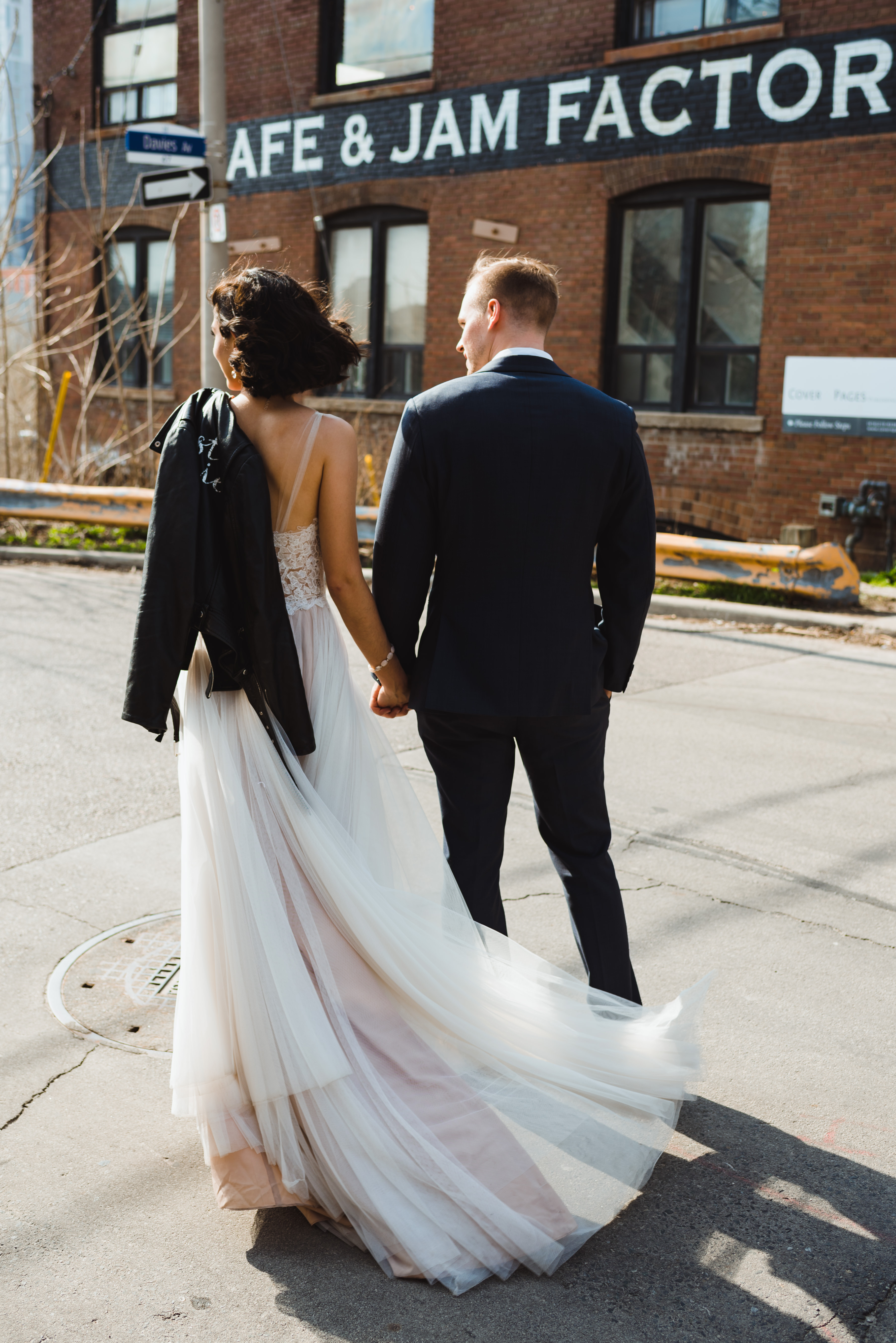 bride and groom crossing street in front of the Jam Factory, Toronto wedding photography Gillian Foster