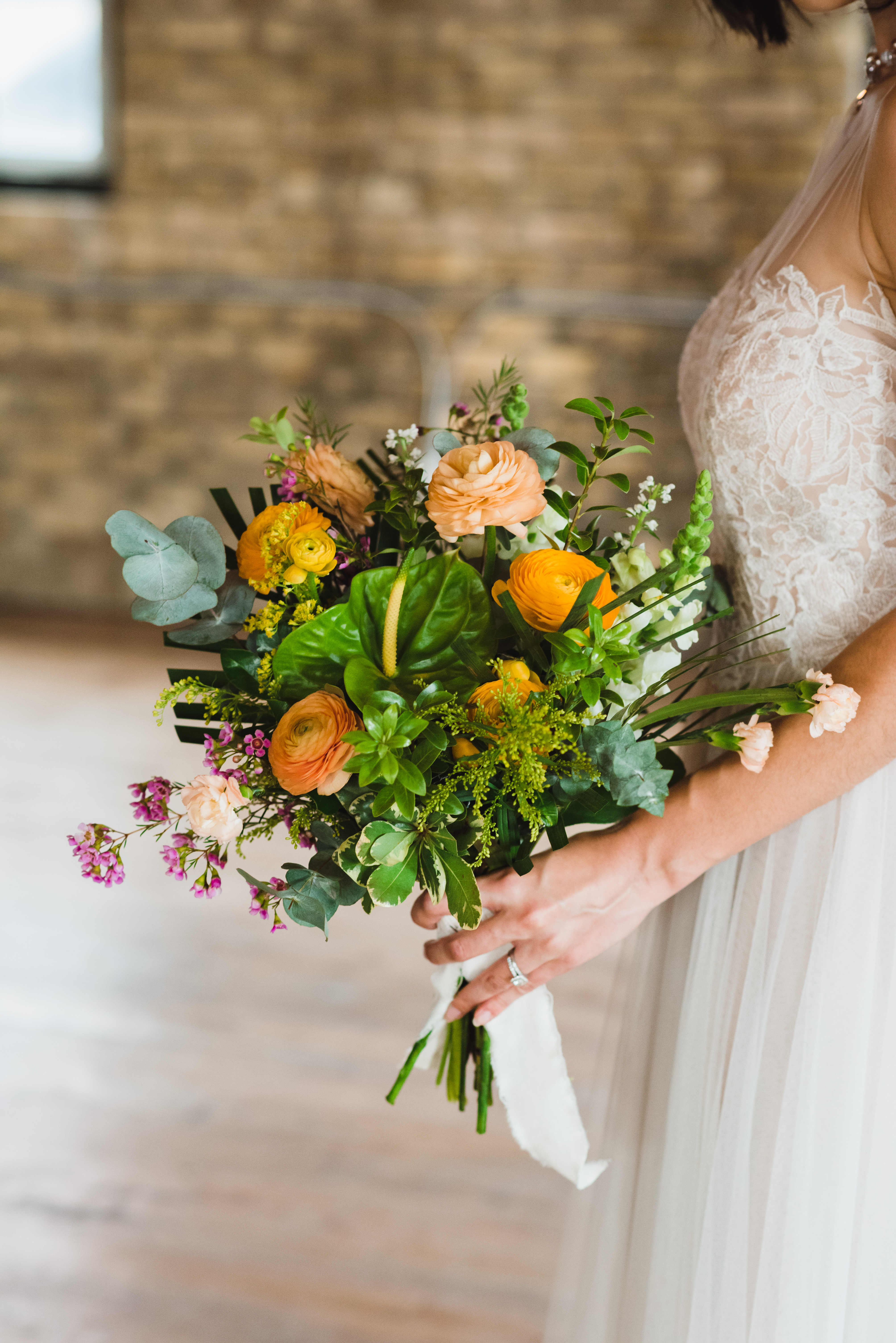 bride holding floral bouquet Toronto wedding photography Gillian Foster