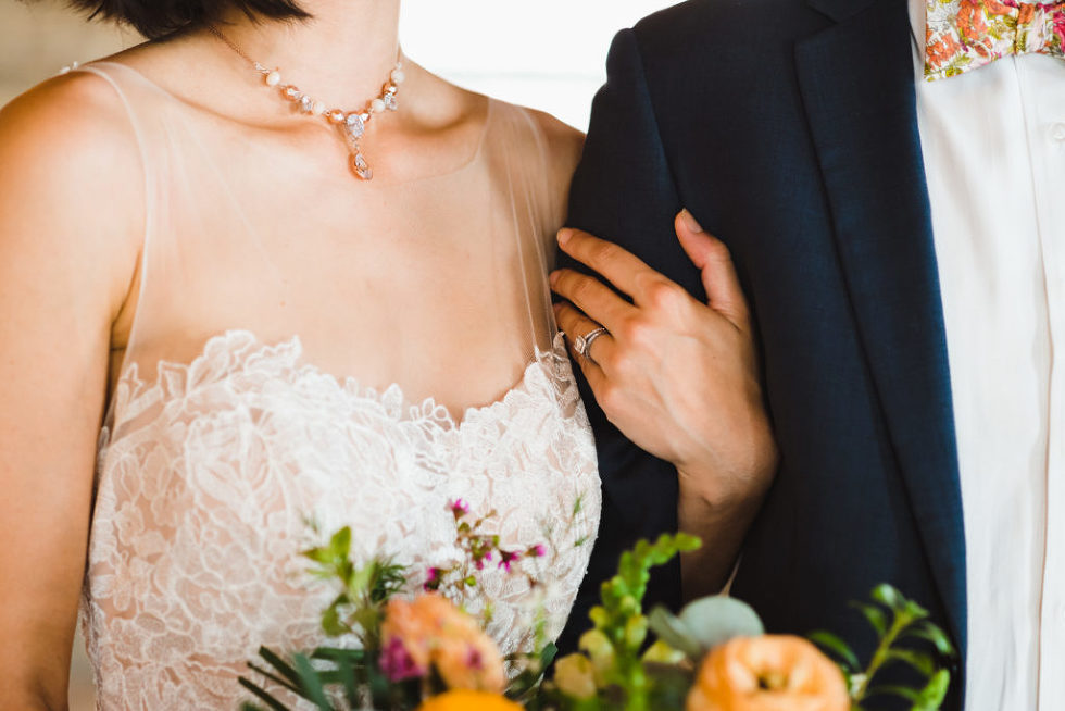 closeup of brides jewellery as she stands next to her groom Jam Factory Toronto wedding photography