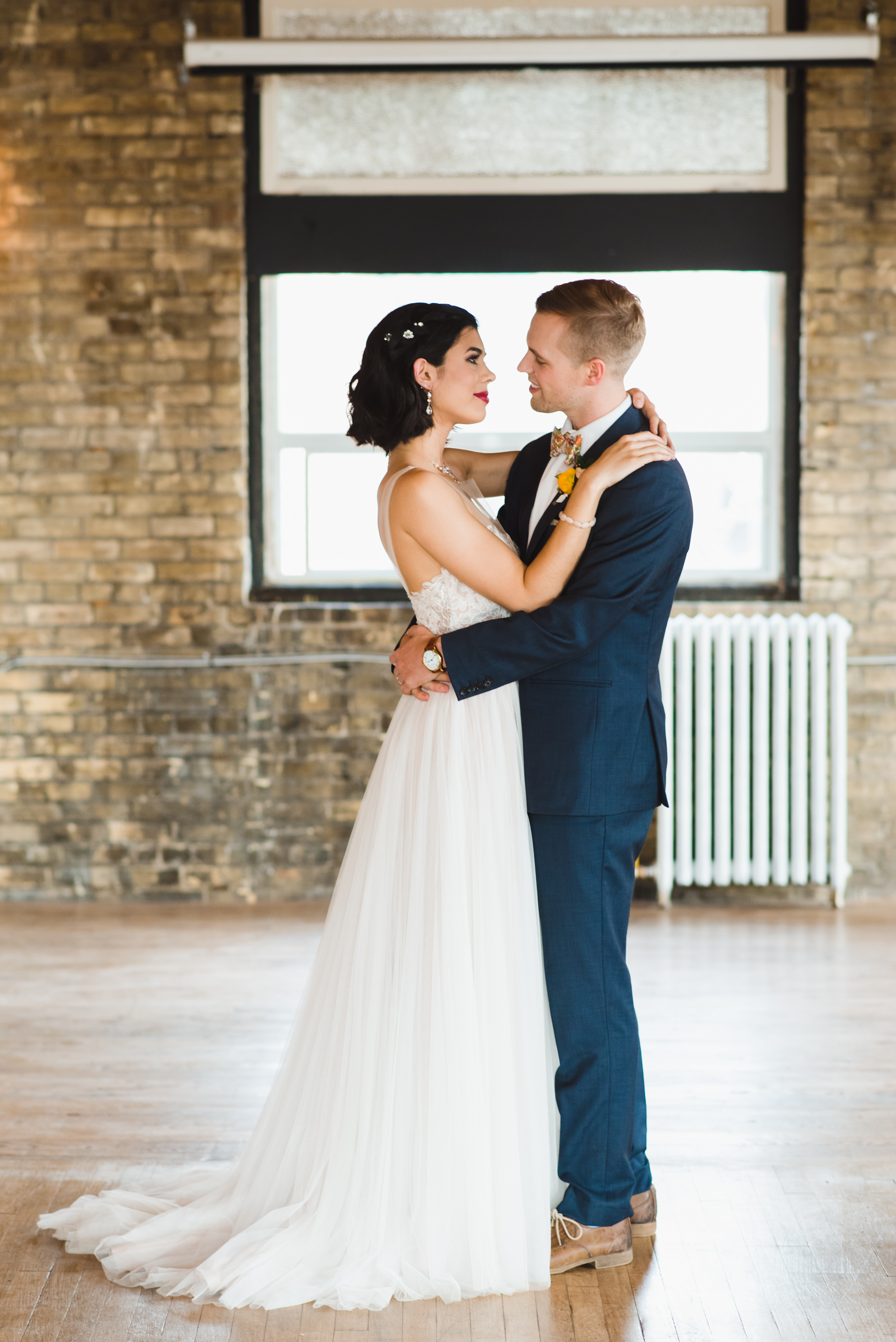 bride and groom in loving embrace at the Jam Factory Toronto wedding photographer Gillian Foster