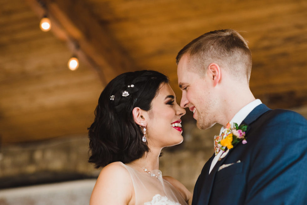 bride and groom smiling at each other in the Jam Factory Toronto wedding photographer Gillian Foster