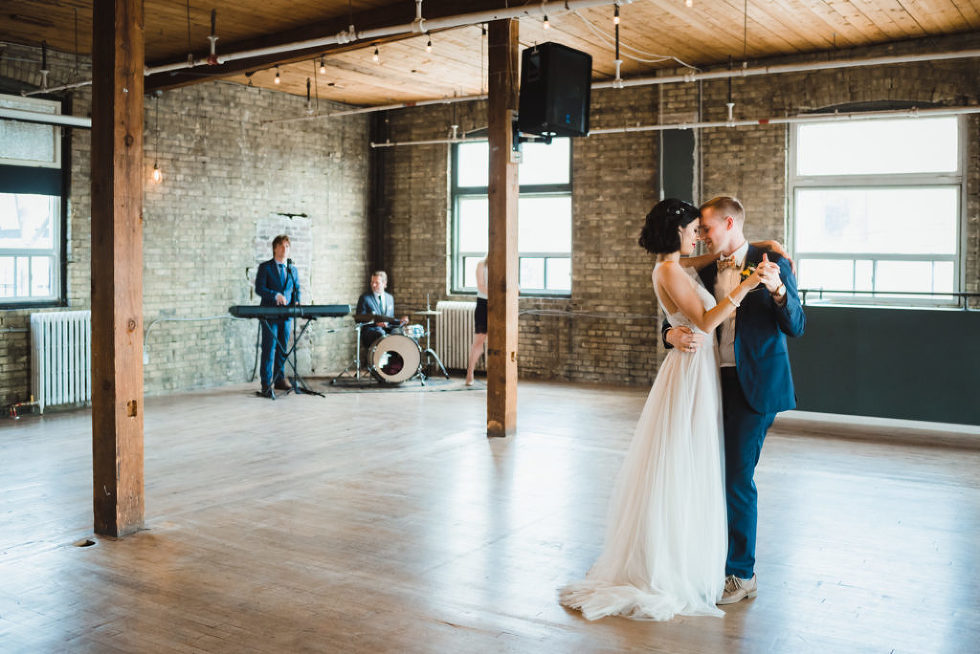bride and groom dancing with 3 piece wedding band in the background at the Jam Factory Toronto wedding photography