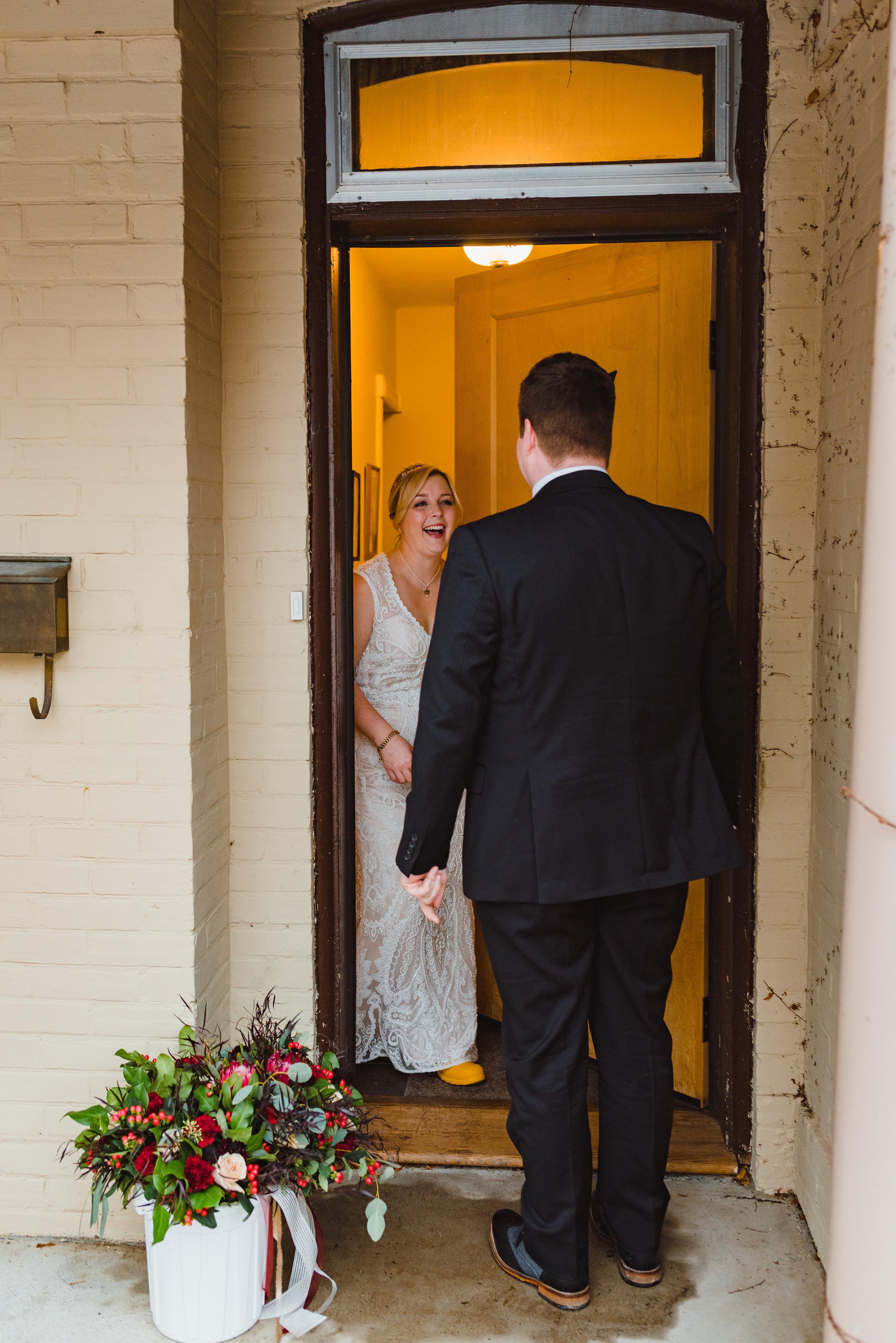 bride opens yellow door to see groom standing before her Canadian Canoe Museum