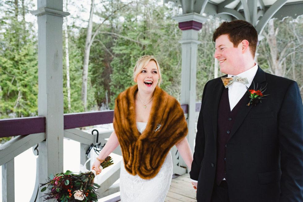 bride and groom strolling through a gazebo Canadian Canoe Museum wedding