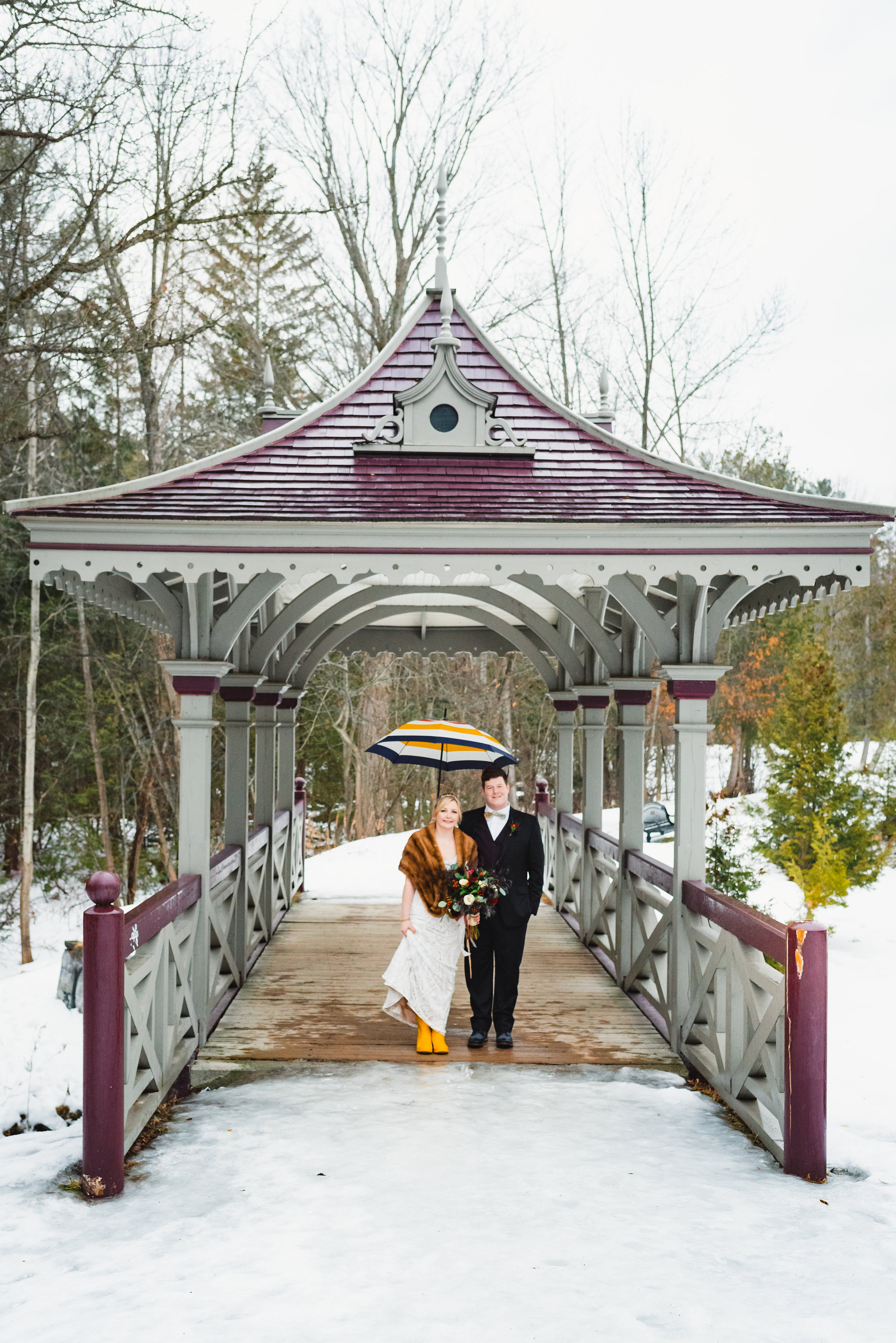 bride and groom standing on covered bride Canadian Canoe Museum wedding