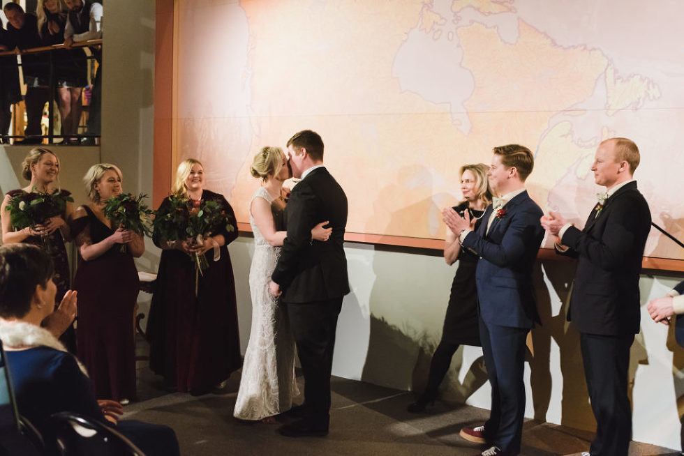 bride and groom kiss to complete the wedding ceremony at the Canadian Canoe Museum Peterborough