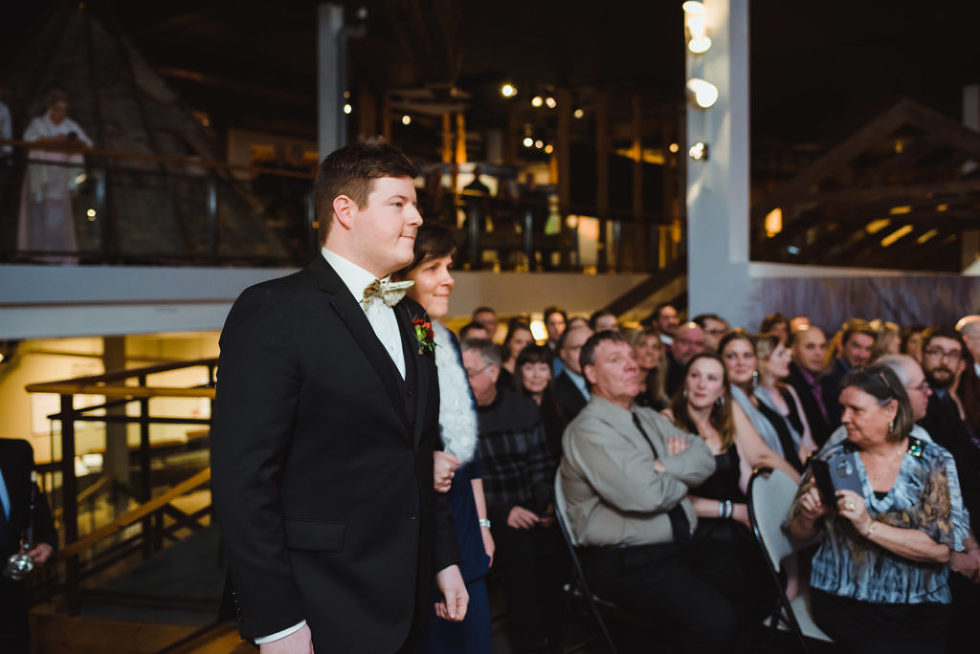 groom walking down the aisle for wedding ceremony at the Canadian Canoe Museum