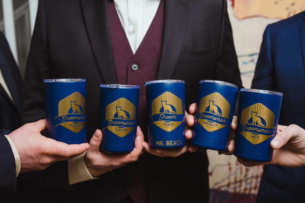 groomsmen and groom holding blue cups up for a toast before ceremony Canadian Canoe Museum wedding