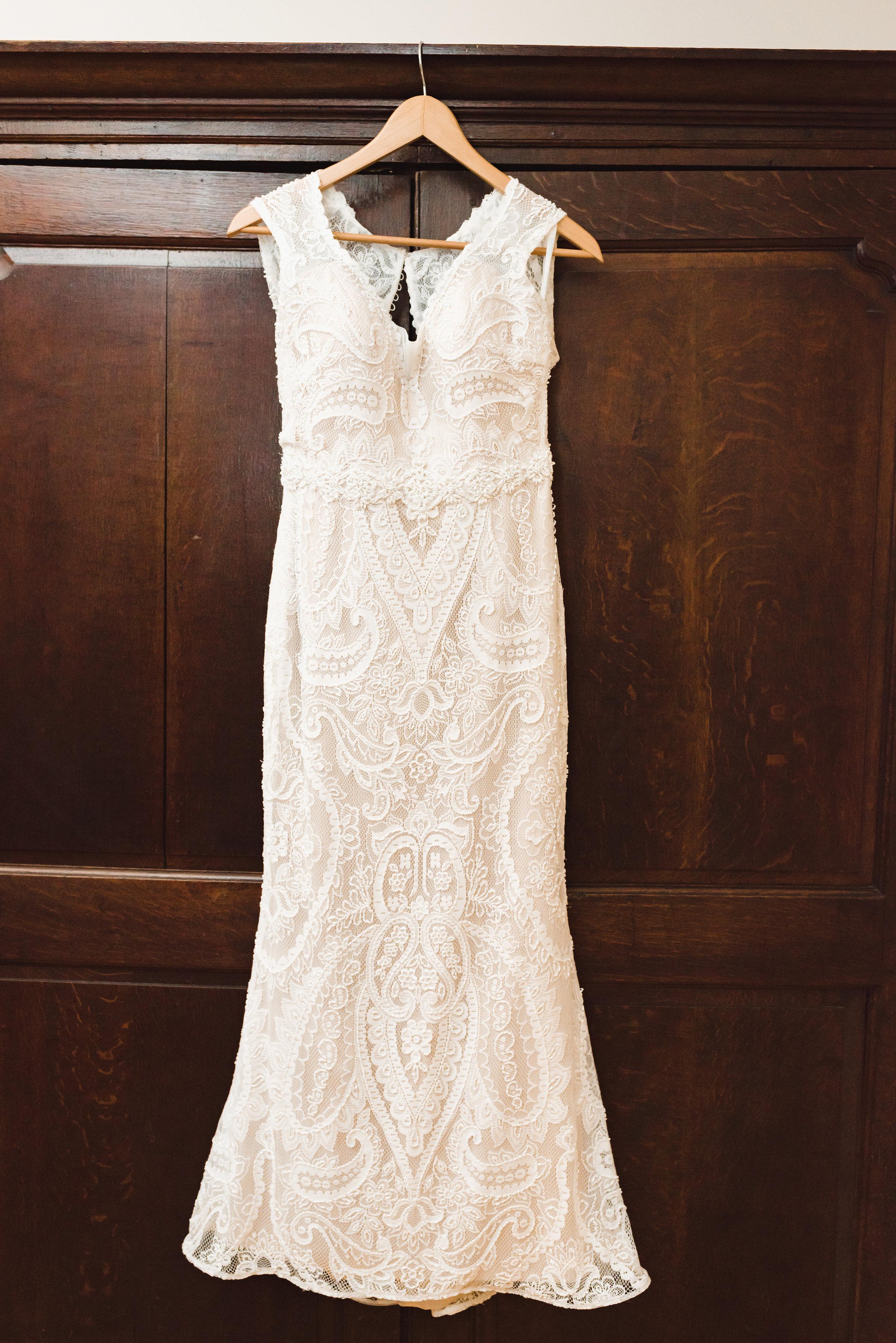 wedding dress hanging from closet Toronto wedding photographer