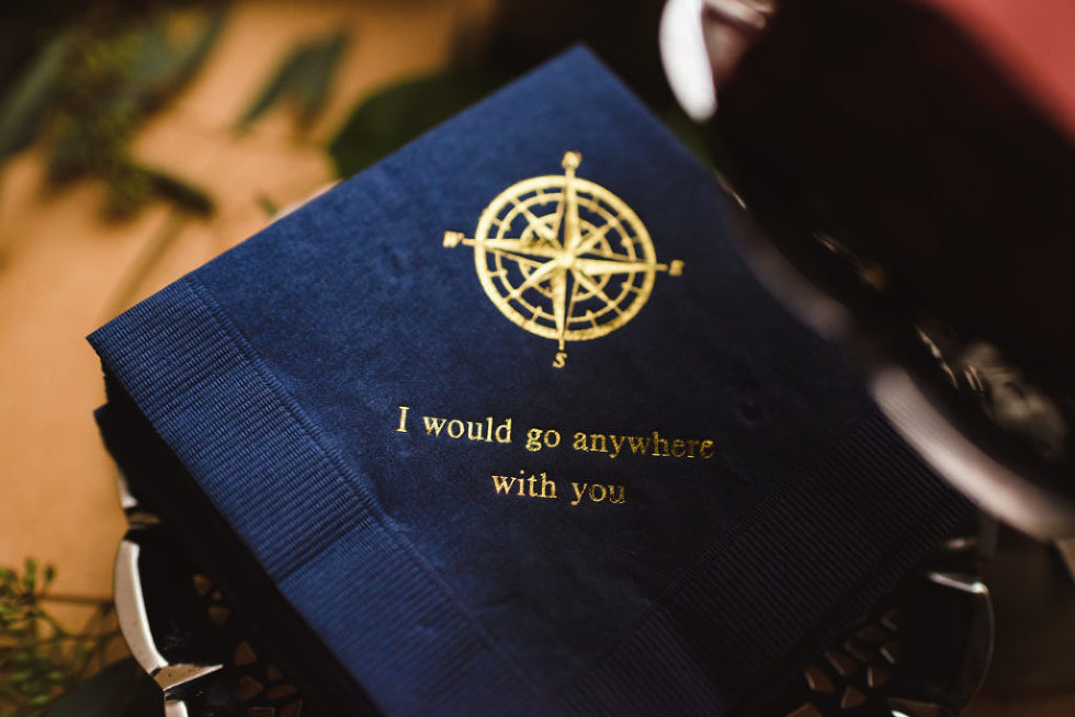 "blue napkin with nautical insignia and inscription ""I would go anywhere with you"" Canadian Canoe Museum wedding"