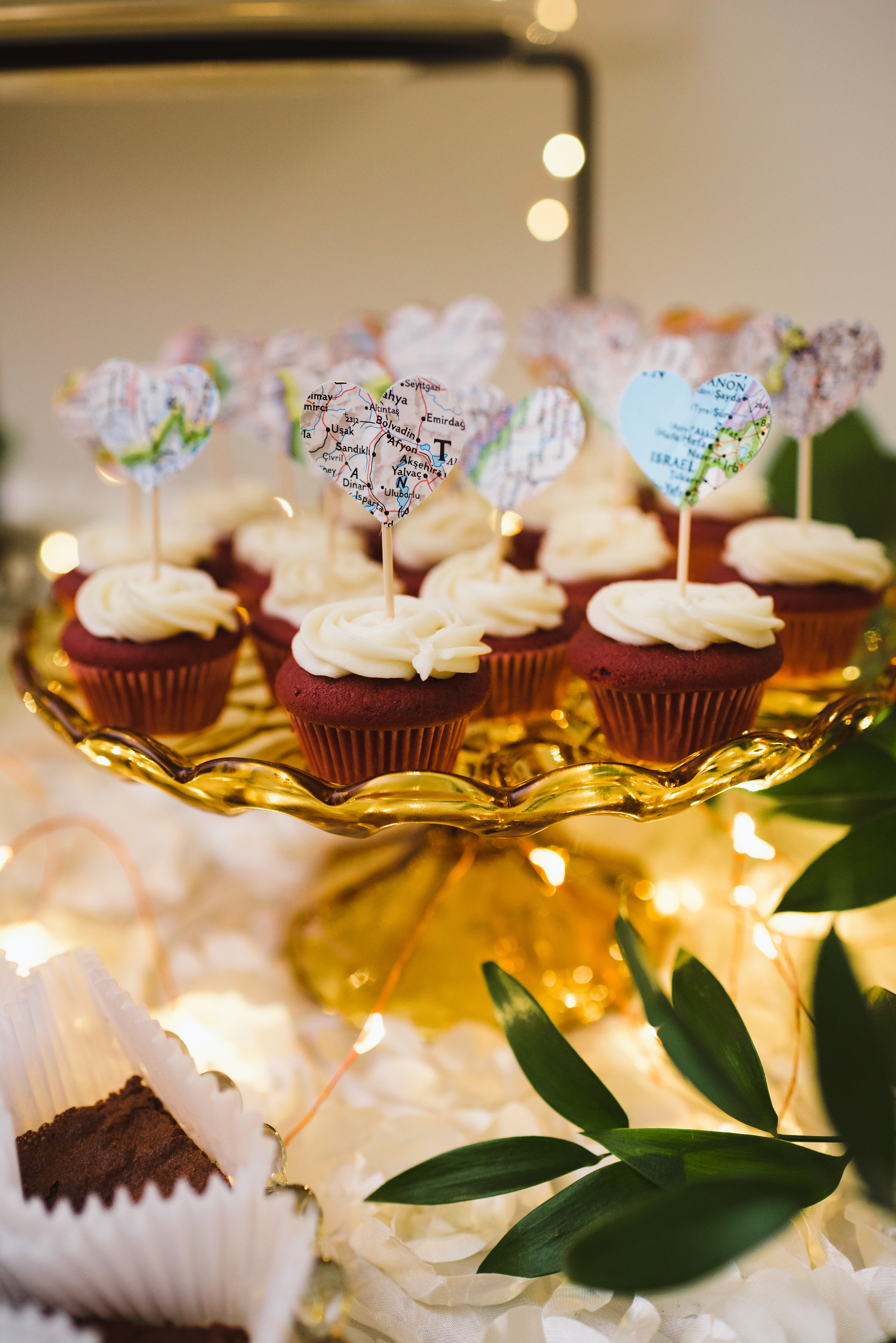 red velvet cupcakes with maps cut into hearts placed into top of them Canadian Canoe Museum wedding