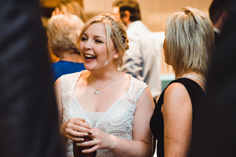 bride smiling during wedding reception at the Canadian Canoe Museum in Peterborough