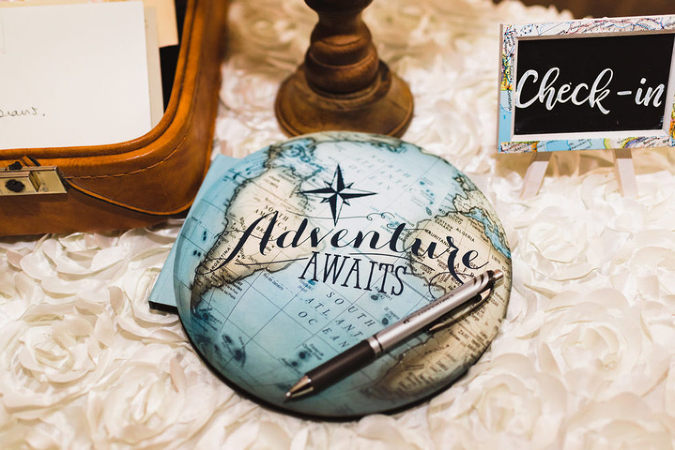 """check in table at a wedding with a map with words written on it saying """"adventure awaits"""" Canadian Canoe Museum"""