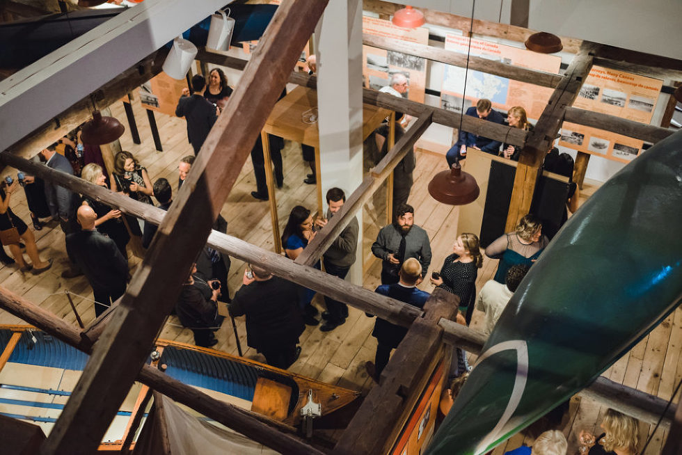 overhead view of the venue space for Canadian Canoe Museum filling with wedding guests