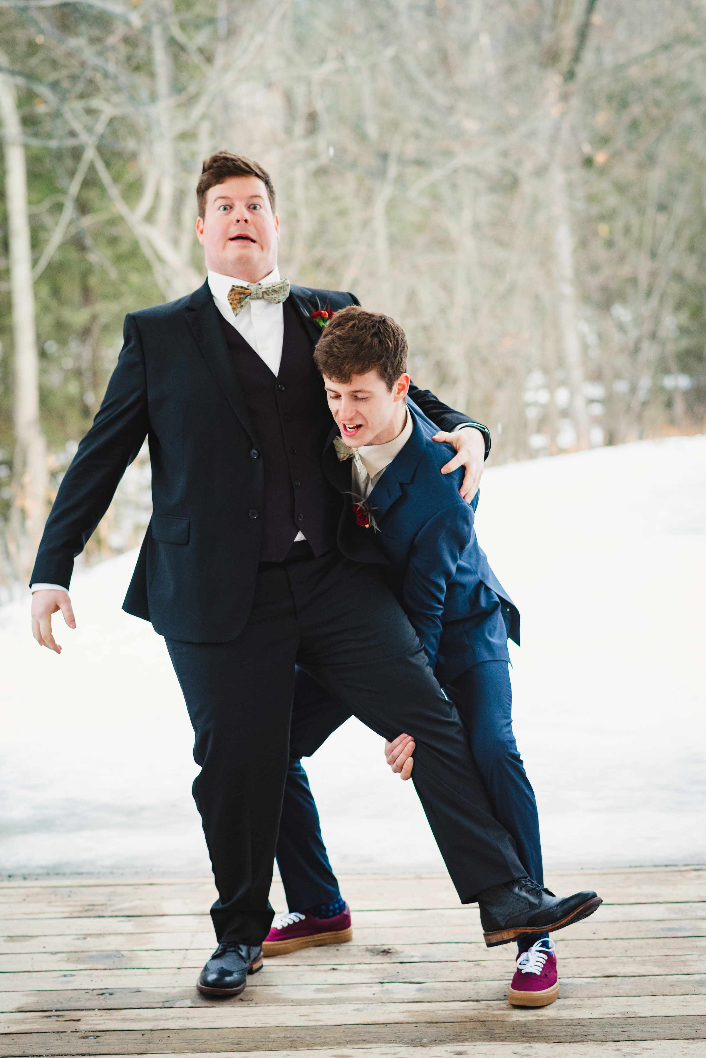 groomsman attempting to pick the larger groom up off the ground Canadian Canoe Museum wedding