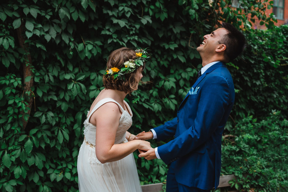 groom smiling as he reacts to first sight of his bride in her dress Toronto brewery wedding photography