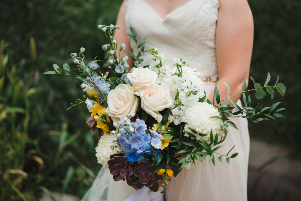 bride in white wedding dress holding her bouquet Toronto brewery wedding photography