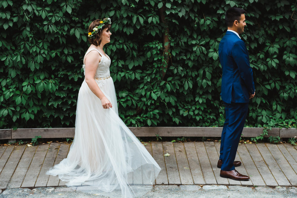 bride approaching groom for their first look Toronto Junction Craft Brewing wedding photography