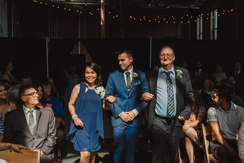 groom walking down the aisle with his parents Toronto Junction Craft Brewing wedding photography