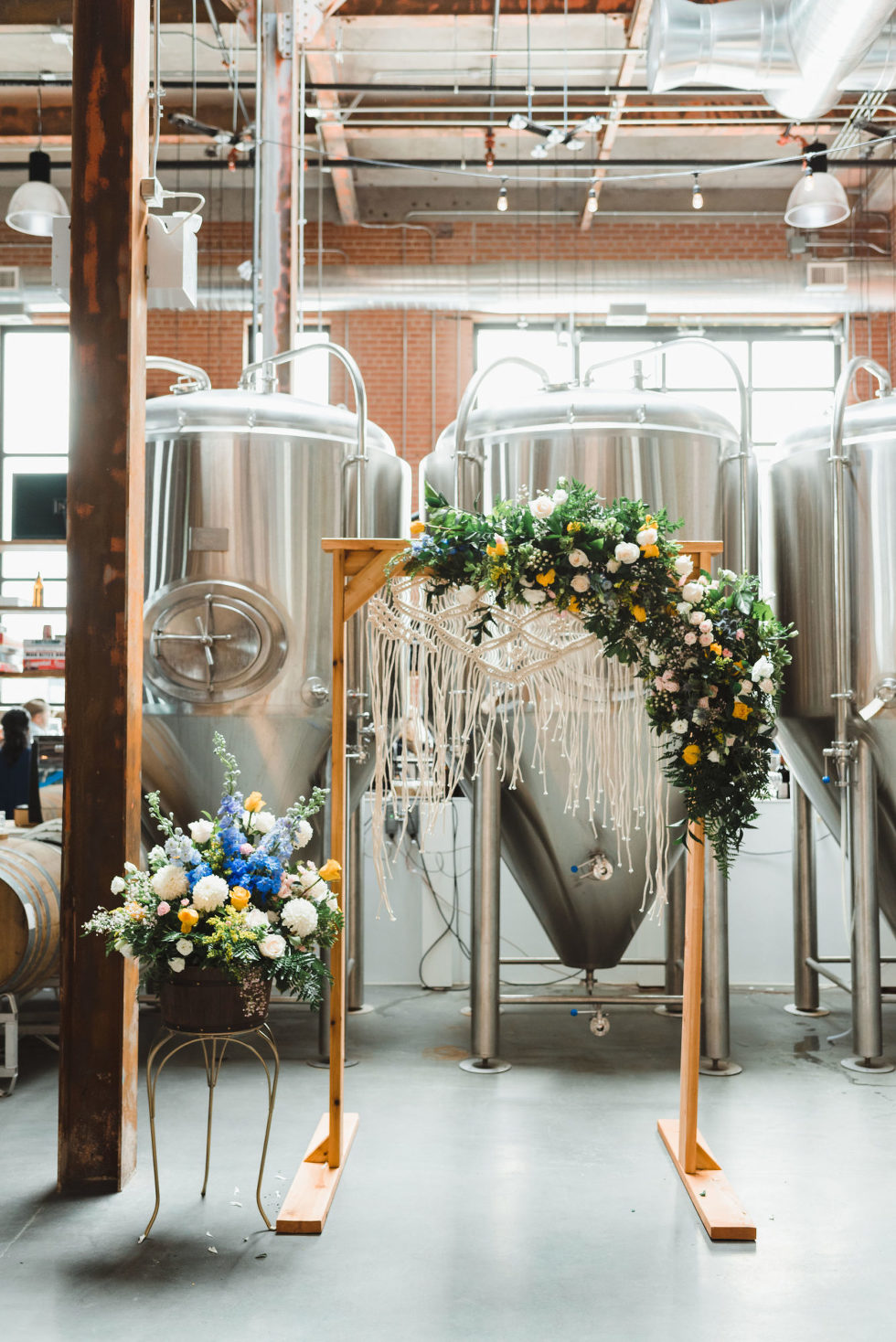wedding alter set up in front of brewing tanks Toronto Junction Craft Brewing wedding