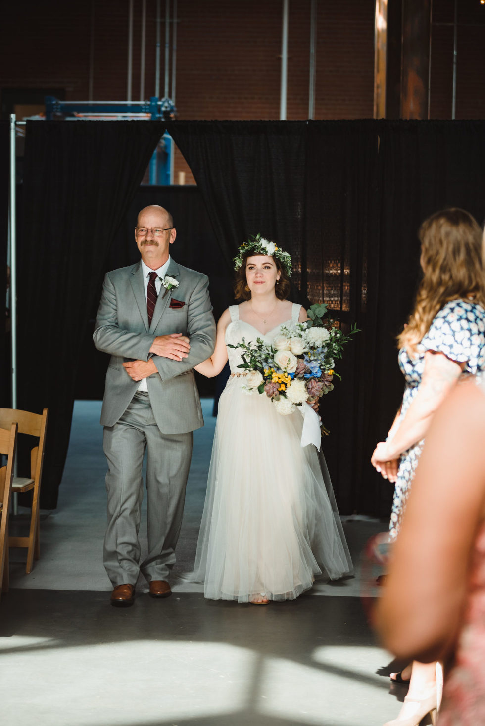 father of the bride escorting his daughter down the aisle Toronto Junction Craft Brewing wedding photography