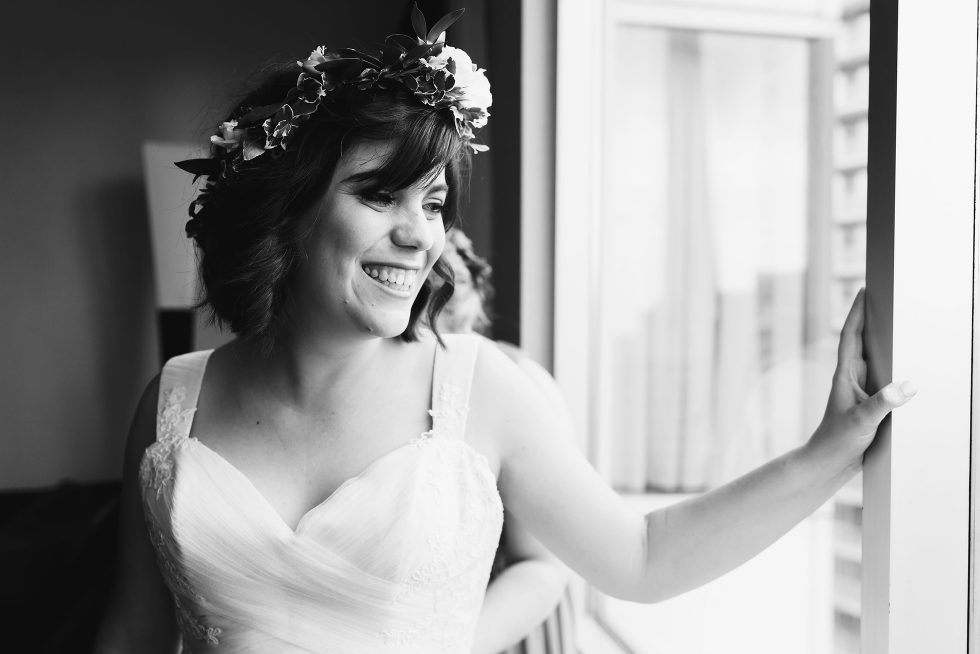bride wearing flower crown with a big smile Toronto wedding photography