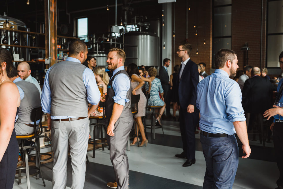 wedding wedding guests mingling at cocktail hour after wedding ceremony at Junction Craft Brewing Toronto wedding photography