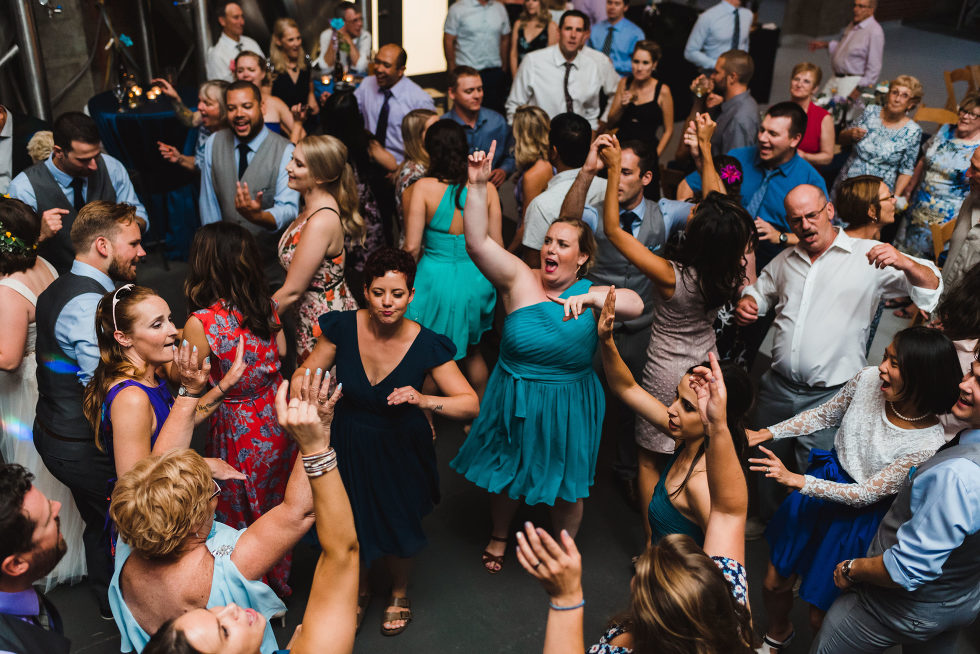 wedding guests dancing wildly on the dance floor Junction Craft Brewing Toronto wedding photography
