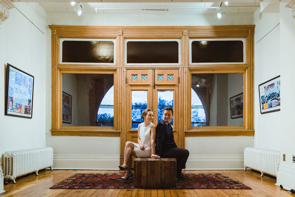 bride and groom sit with back to each other in the Gladstone Hotel in Toronto how to best plan your wonderful wedding your way