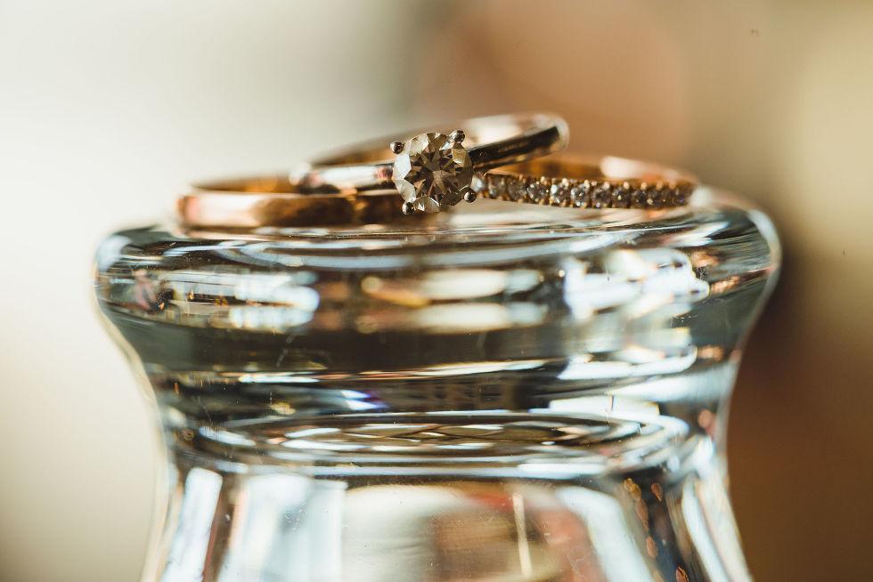 wedding bands resting on upside down pint glass Henderson Brewing Company wedding Toronto