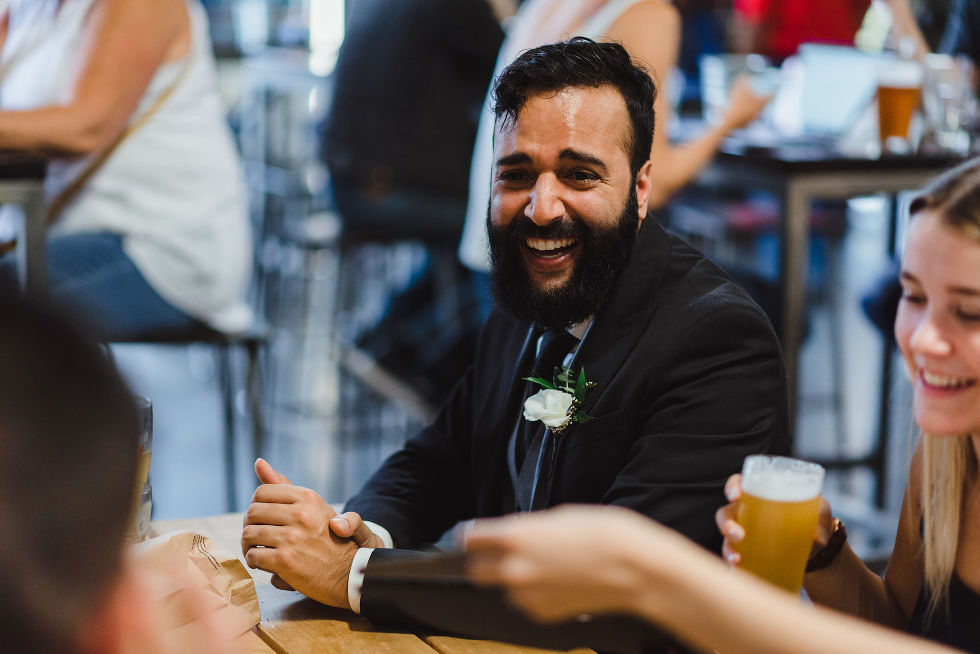 wedding guest laughing during cocktail hour at Henderson