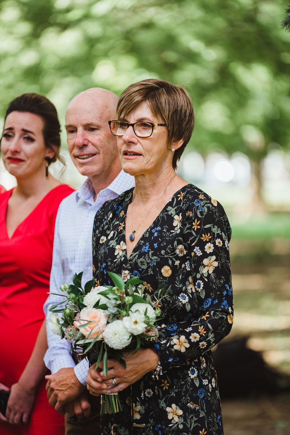 family members crying during wedding ceremony Trinity Bellwoods Park Toronto