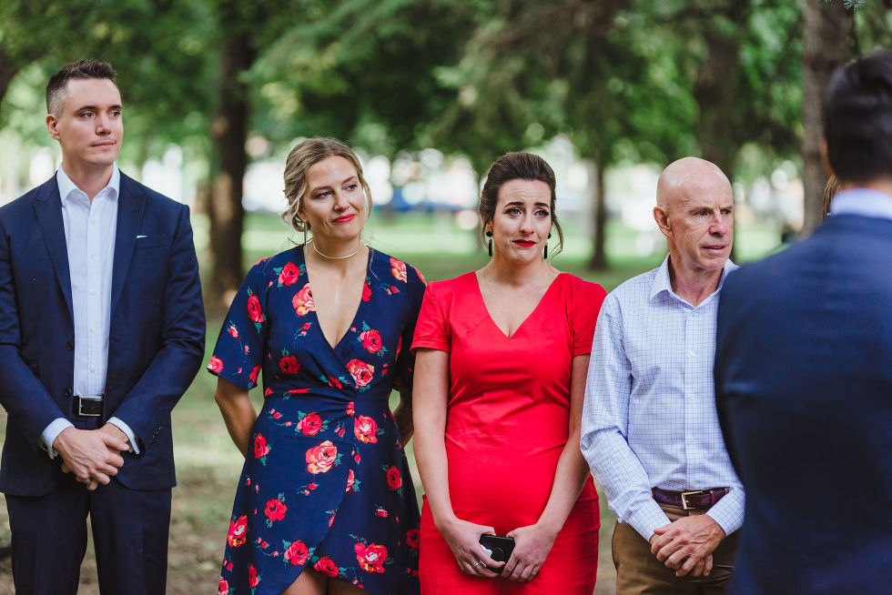 wedding guests tearing up during ceremony in Trinity Bellwoods Park Toronto