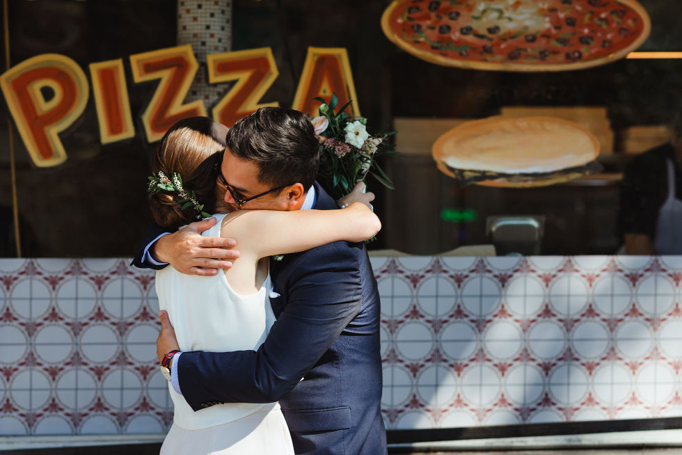bride and groom hugging in front of Bitondo