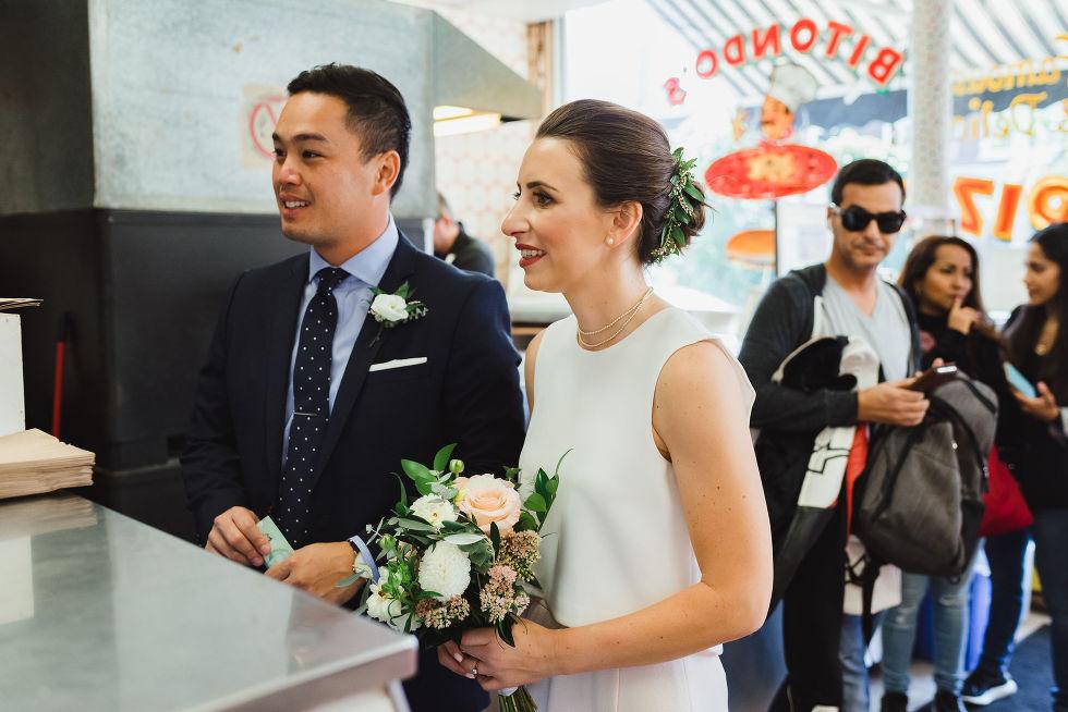bride and groom ordering a pizza at Bitondo