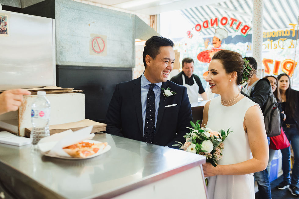 bride and groom smiling and ordering a pizza at Bitondo