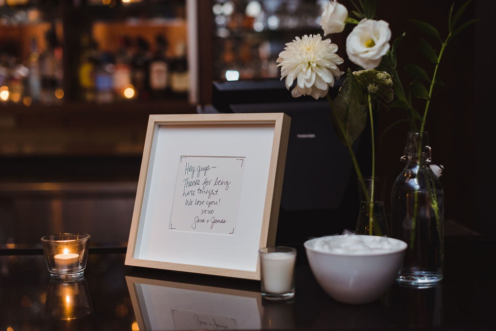 flowers, picture frame, and candles at wedding reception in the Gladstone Hotel Toronto wedding photographer Gillian Foster