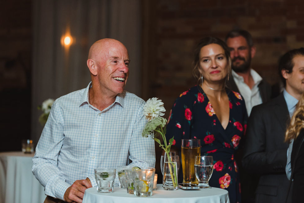 father of the bride laughing during wedding speeches at the Gladstone Hotel in Toronto