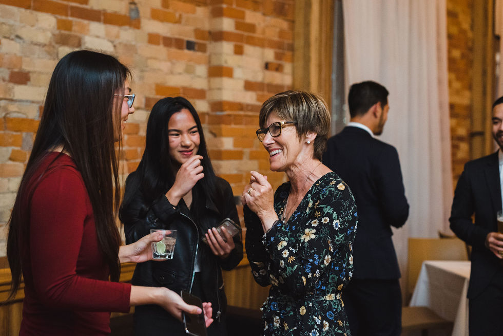 mother of the bride smiling and chatting with wedding guests during reception at the Gladstone Hotel Toronto