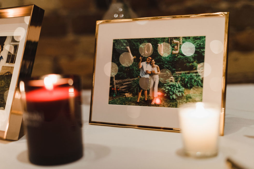 table with candles and picture frame with an old picture of the bride and groom Gladstone Hotel Toronto