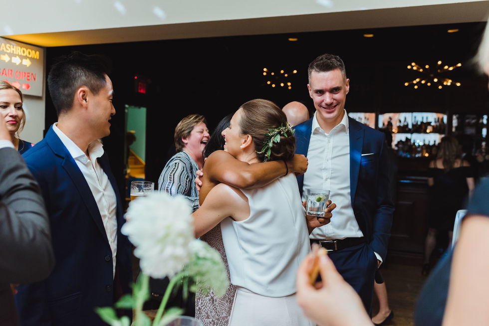 bride hugging a wedding guest during the reception at the Gladstone Hotel in Toronto