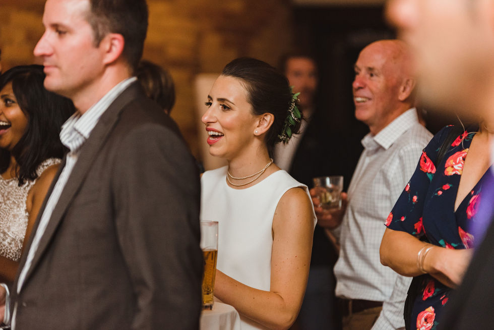 bride and wedding guests watching and smiling during speeches at the Gladstone Hotel in Toronto