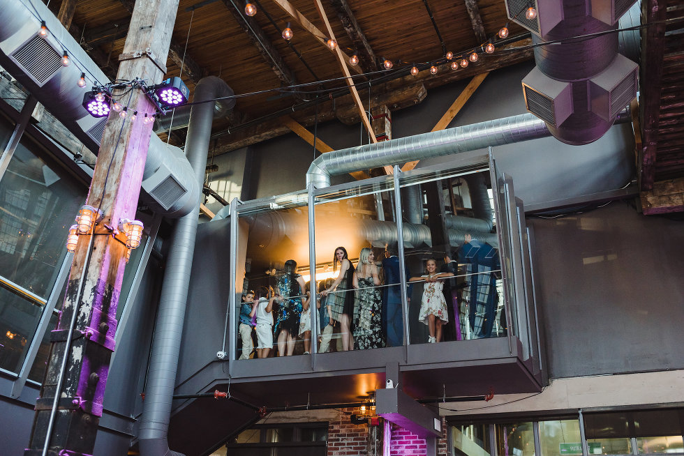 wedding guests overlooking venue from 2nd floor at Steam Whistle Brewing Toronto Canada