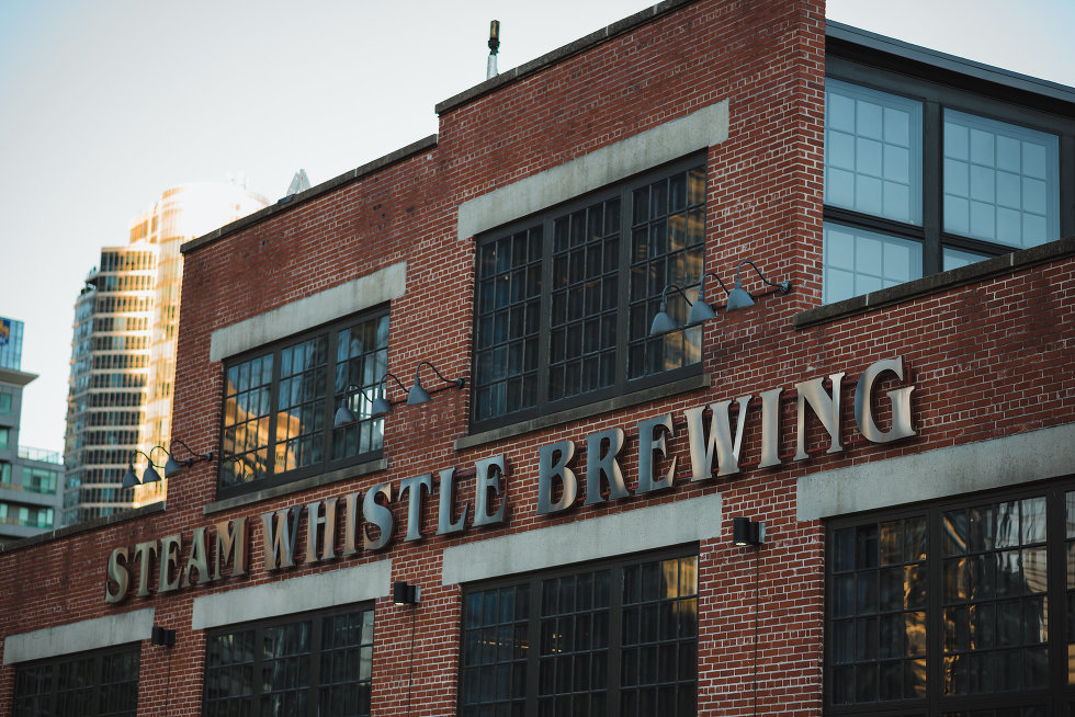 red brick facade of Steam Whistle Brewing with metallic sign Toronto wedding venue