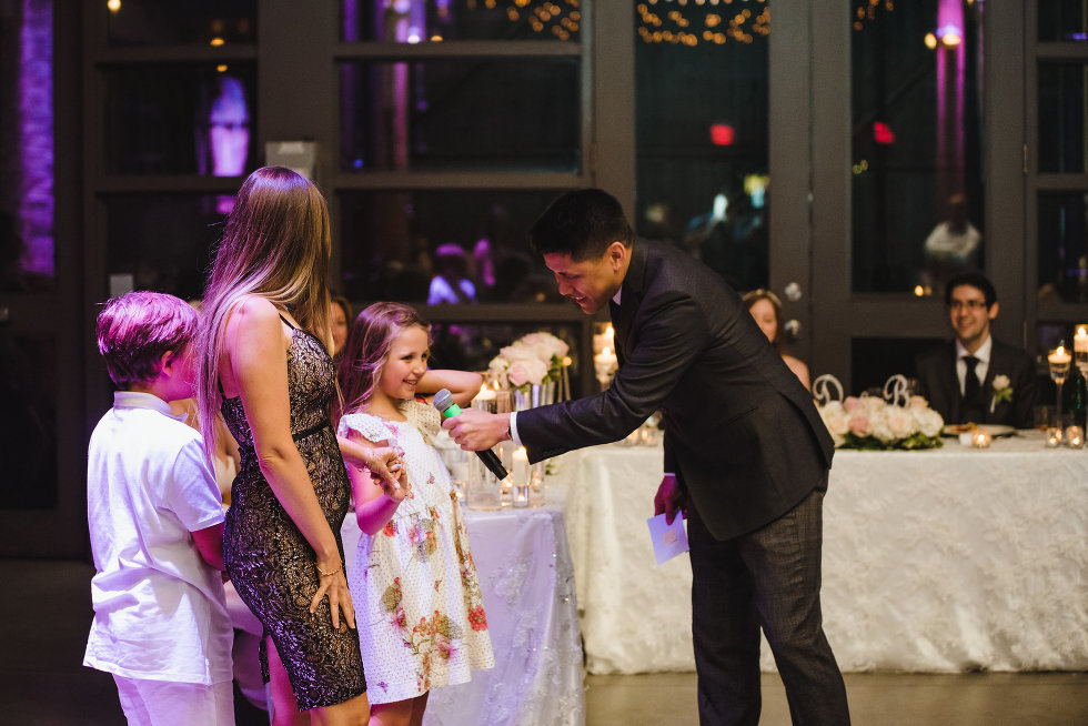child speaking into microphone during a wedding at Steam Whistle Brewing Toronto Canada