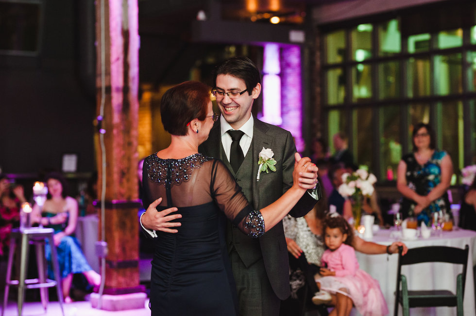 groom dancing with his mother during wedding at Steam Whistle Brewing