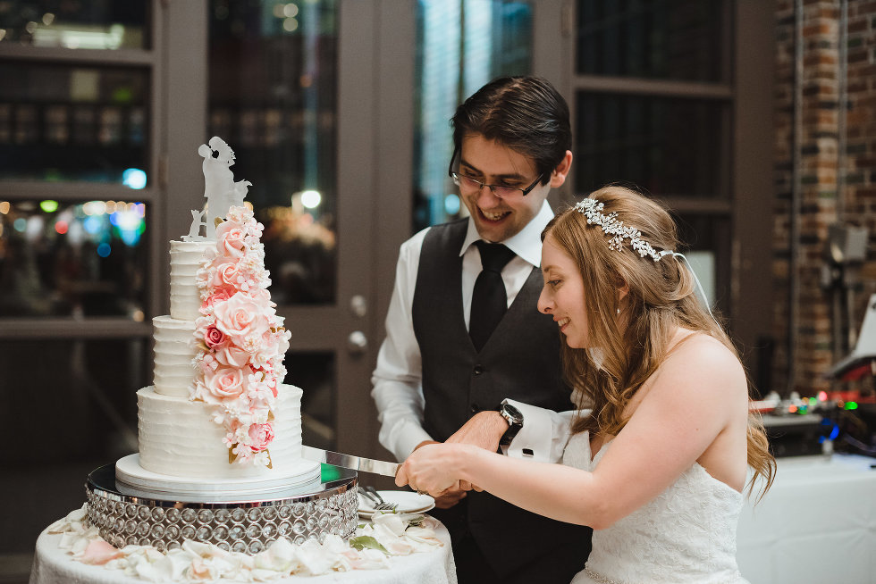 bride and groom cutting their wedding cake at Steam Whistle Brewing